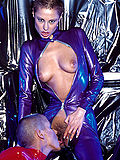 Shaved head fetish lesbians fuck in shiny catsuits