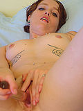 Tattooed alt chick fucks self with clear dildo