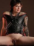 Tattooed shaved guerilla girl corset high heels