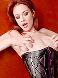 Sexy Justine Joli in decorative steel fantasy corset