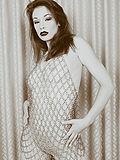 Justine Joli in sexy chain dress