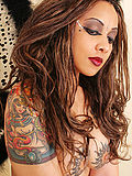 Sexy tattooed babe in fun Gothic fairy cosplay