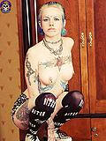Sexy tattoo punk girl strips off skull gear