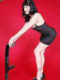 pinup cutie poses with a shotgun