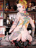Ultra hot tattooed punk rock babe Rachel Face naked at the punk bar