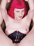Curvy pink haired slut in corset spreads legs wide