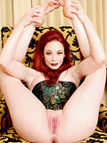 Porn's favorite redhead resplendent in a to-die-for corset