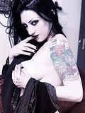 Very busty black haired vampire girl in velvet