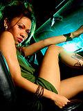Naughty tattooed asian girl strips strokes in car