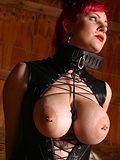 busty redhead in tight sexy bondage