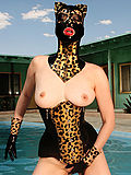 Pervy rubber fetish cat girl gets wet