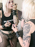 Hot blonde slips into a strap on dildo