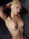 Blonde strips off chinese dress and spreads